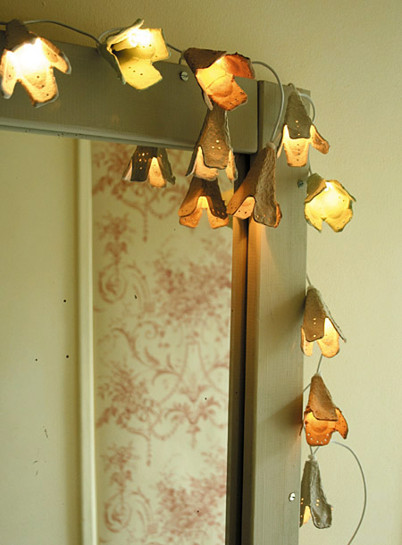 Very shabby-chic.     Fairy lights,DIY decorative objects