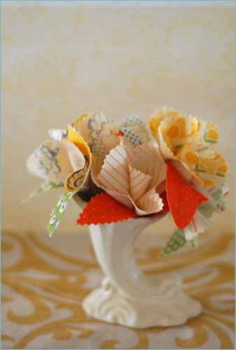 Very cute DIY fabric flowers tutorial.  It says boutonnières, but I think they can be used for anything. (via  Once Wed  )