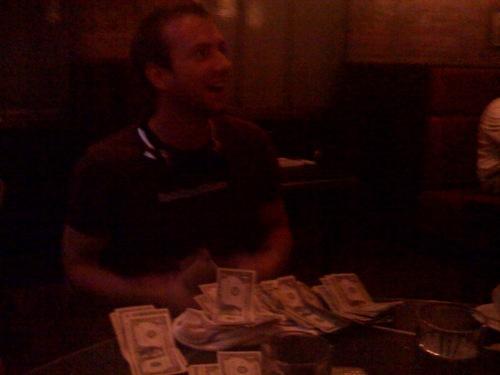 Charles paying his bill…