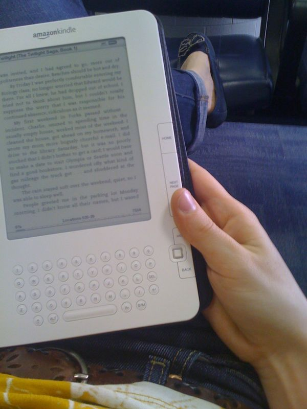 I'm quicky falling in love with the Kindle. I didn't think I would like it, but we're really bonding sitting here in the airport waiting to fly to Utah and reading a teenage vampire book together.