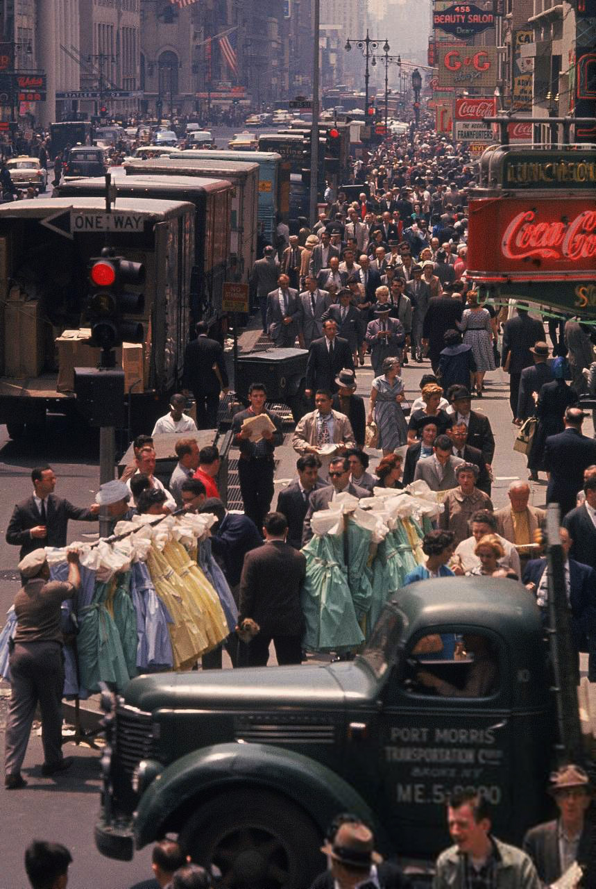 Today, people are still pushing racks of clothing down 7th Ave. and nobody moves.   7th Ave.  Summer in the Sixties .   (via  nevver )