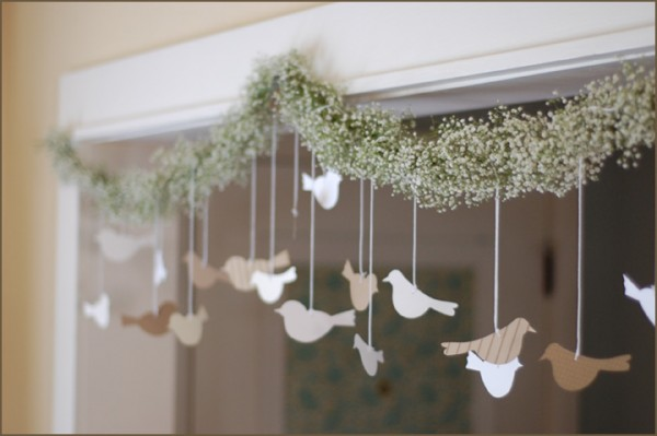 Pretty.  I think I might just make this anyway and pretend it has nothing to do with weddings.    DIY: Bird and Flower Garland | Once Wed