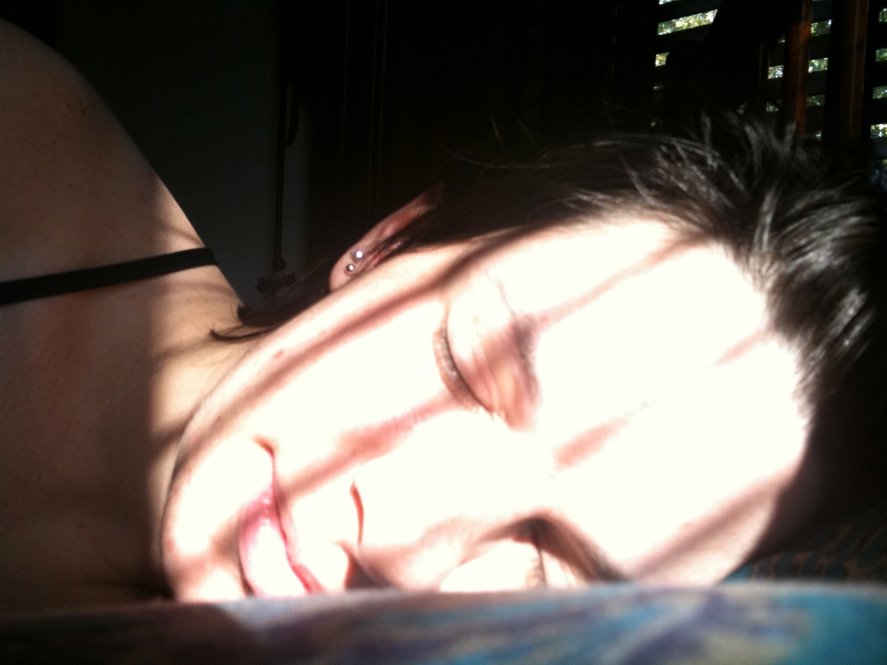 GPOYW.    The sun gets really bright in our bedroom and the reflection off my face wakes up Marco.