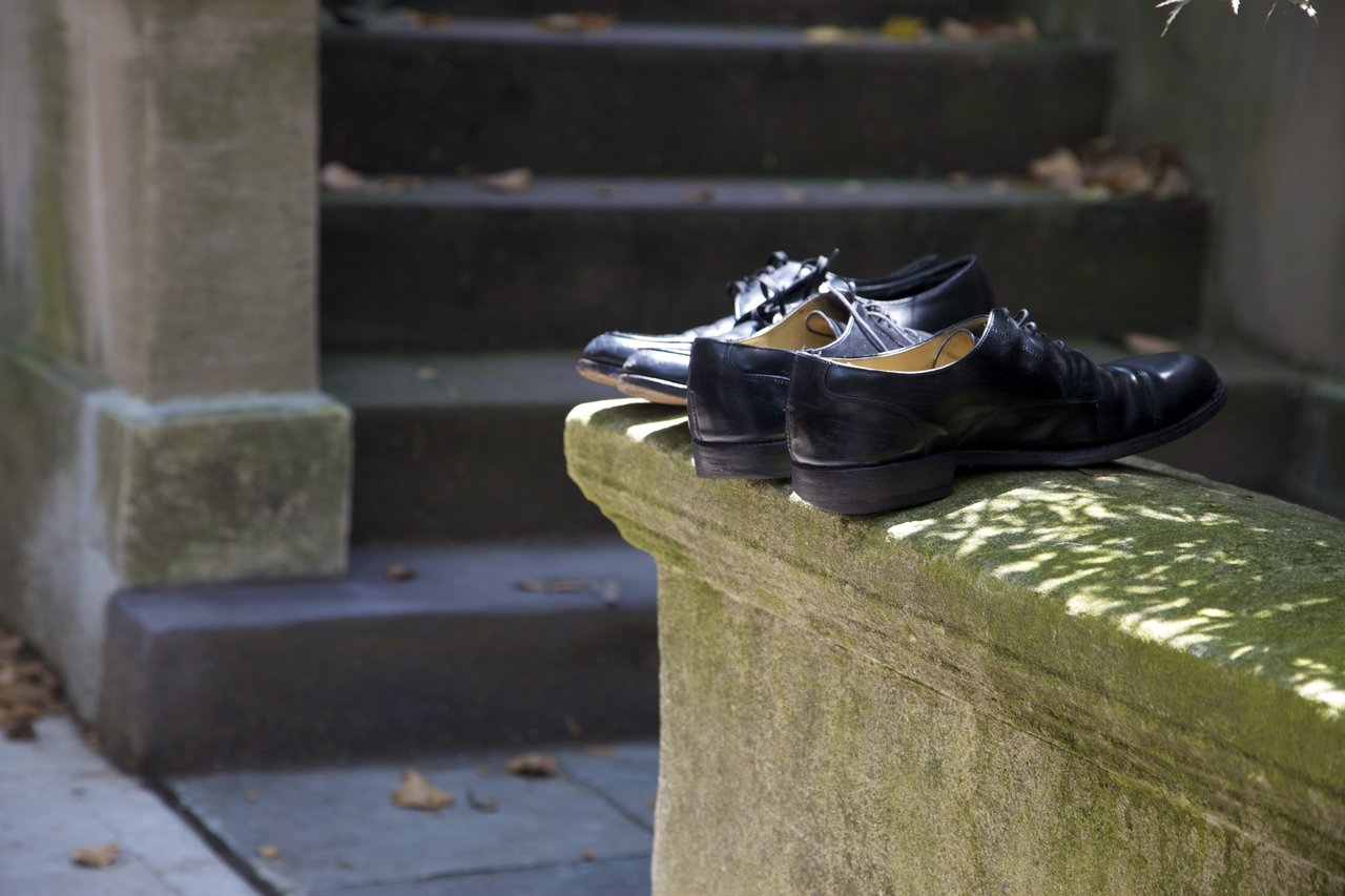 One week after a funeral, these shoes are out on the neighbor's stoop.