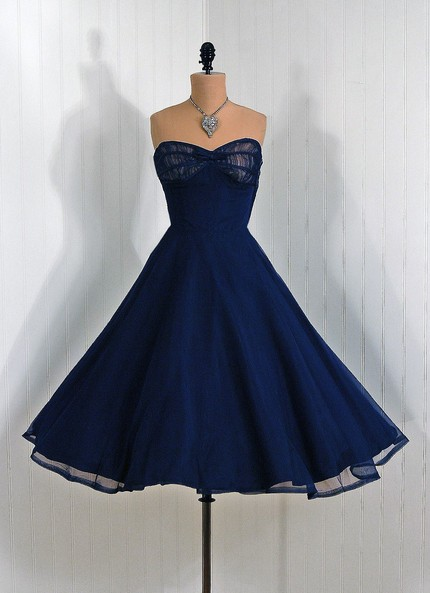 This is such a beautiful dress. Someone needs to buy this and let me photograph you in it.    1950's Vintage NavyBlue Illusion Strapless by TimelessVixenVintage
