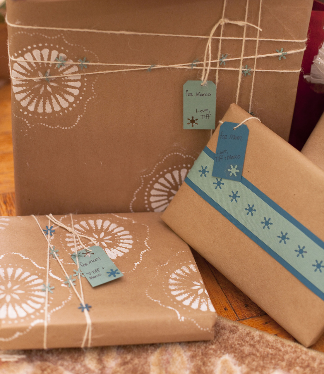 I really get into wrapping presents.  I love using simple kraft paper and then spicing it up with all kinds of crafty decorations.