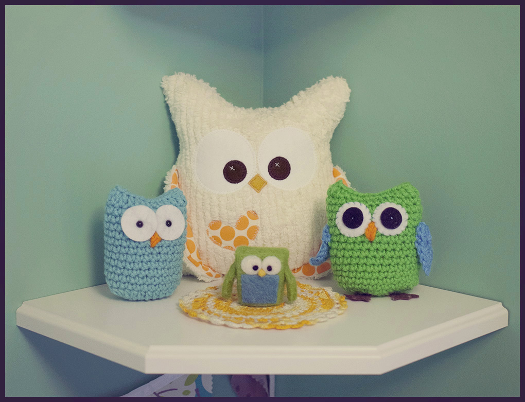 "In Adam's room, we have a shelf of owls. His entire life, I would hold him up to see the owls and sing, ""The owls go Hoot Hoot!"". This past month we were all playing on the floor in Adam's room and I started singing, ""The owls go Hoot Hoot!"". Adam turned around and pointed directly at the shelf of owls. We were so excited! It was the first time he deliberately gestured to something we were talking about and really showed that he as been listening to us!  Owls:   blue and green crocheted owls:  California Sweet Peas   square felted owl:  feltjar   large plush white owl:  April Foss, I Sew Lucky"