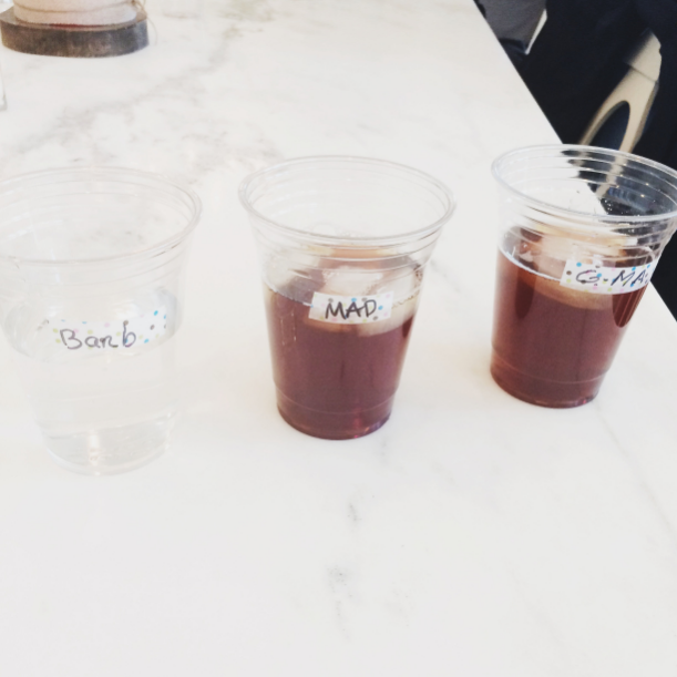 Placing a small piece of cute washi tape on plastic cups was a cute and easy way to let people mark their names on their cups!