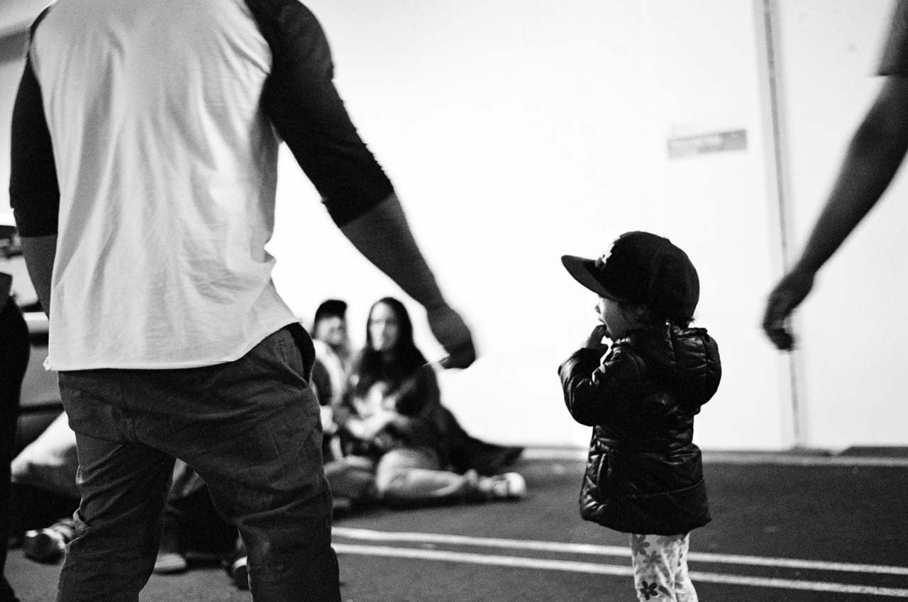 i really like this photo. girl with her father from the wellington krumping group.