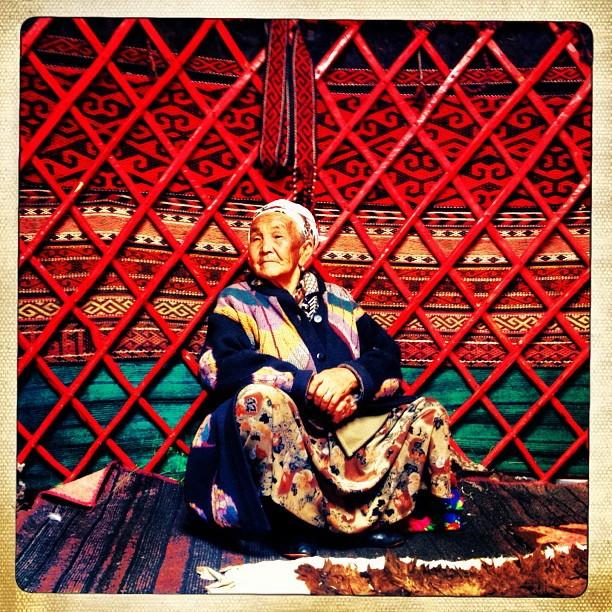 Ajay Nurza sits in her family's yurt in a jailoo near Gulcha in Southern Kyrgyzstan. Rural residents will take their livestock to pasture land known as jailoo during the summer months for grazing before the winter comes. The yurt is made of several pieces of wood wrapped in felt and can be packed and moved within a day.