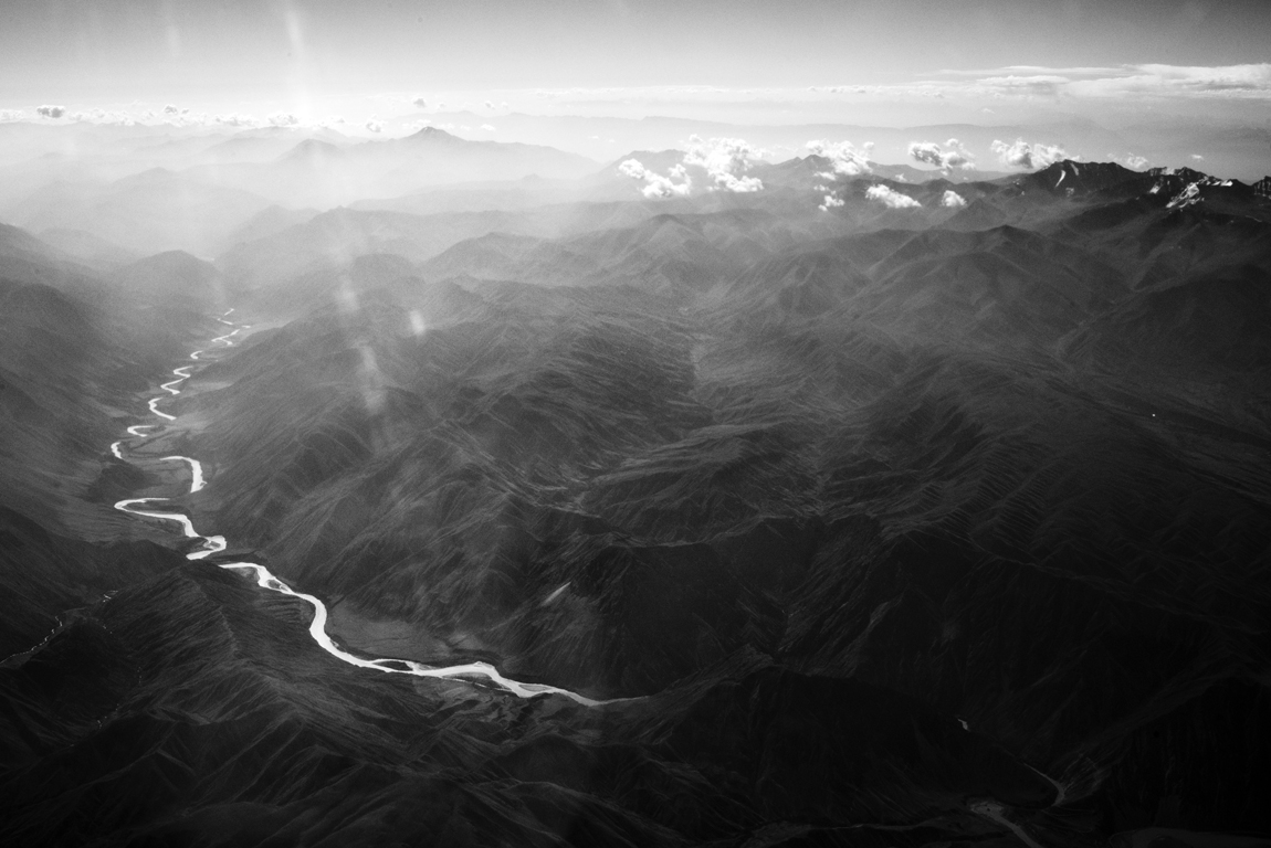 Somewhere in the Tien Shen (translated Celestial) mountain range between Osh and Bishkek. Sorry for light refraction… taken out of window