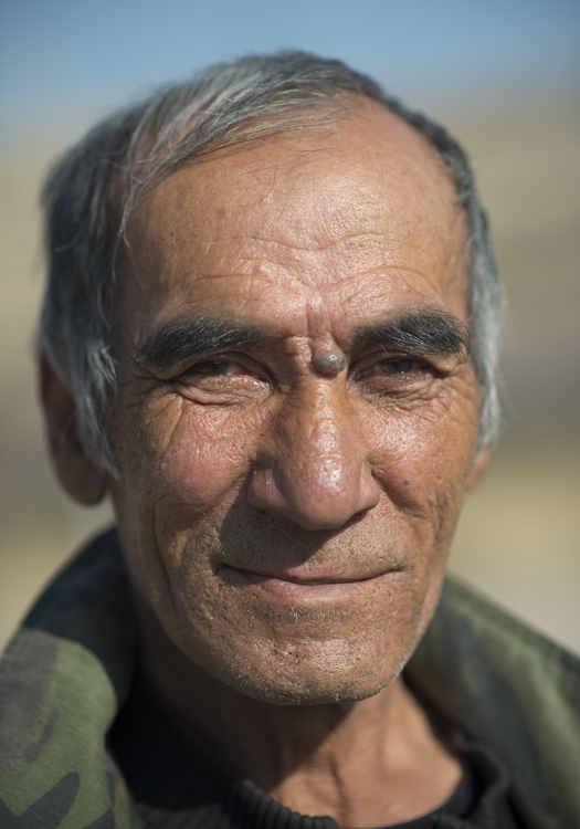While laughing, Azziz apologized for fighting against American forces during the Vietnam War. A Soviet Army recruit from Kyrgyzstan, he was based in Yung Yang, Vietnam during 1968 and 1969.   The Soviet Union was never officially involved in the Vietnam.   photographed in Ala Buka, Kyrgyzstan