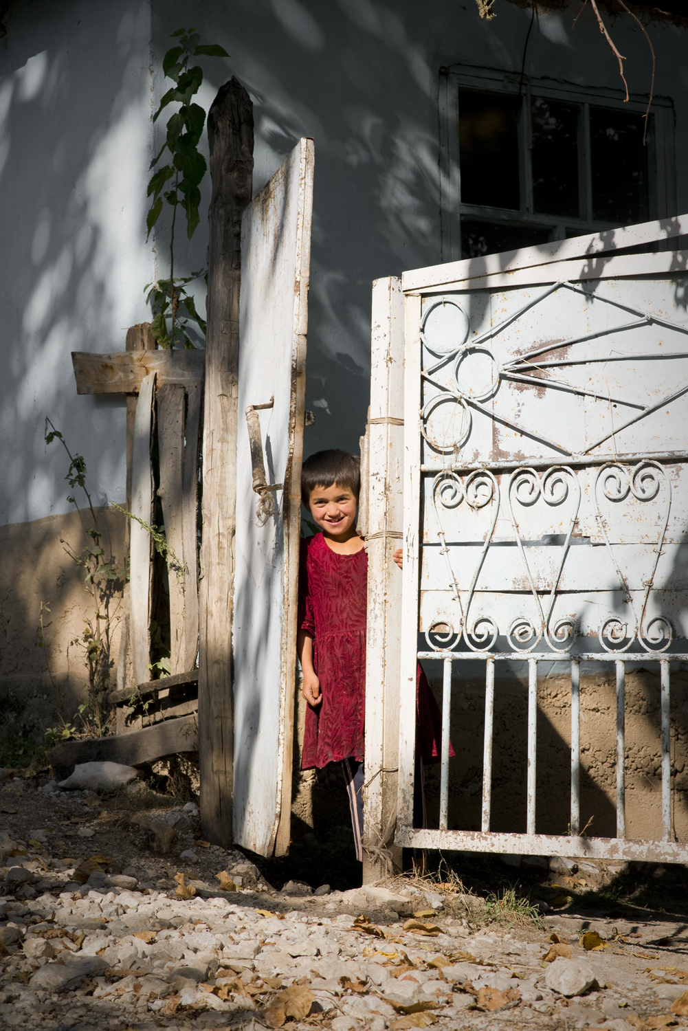 Latifya stands by the door to her home in the mono-ethnic town of Arslanbob in Southern Kyrgyzstan.