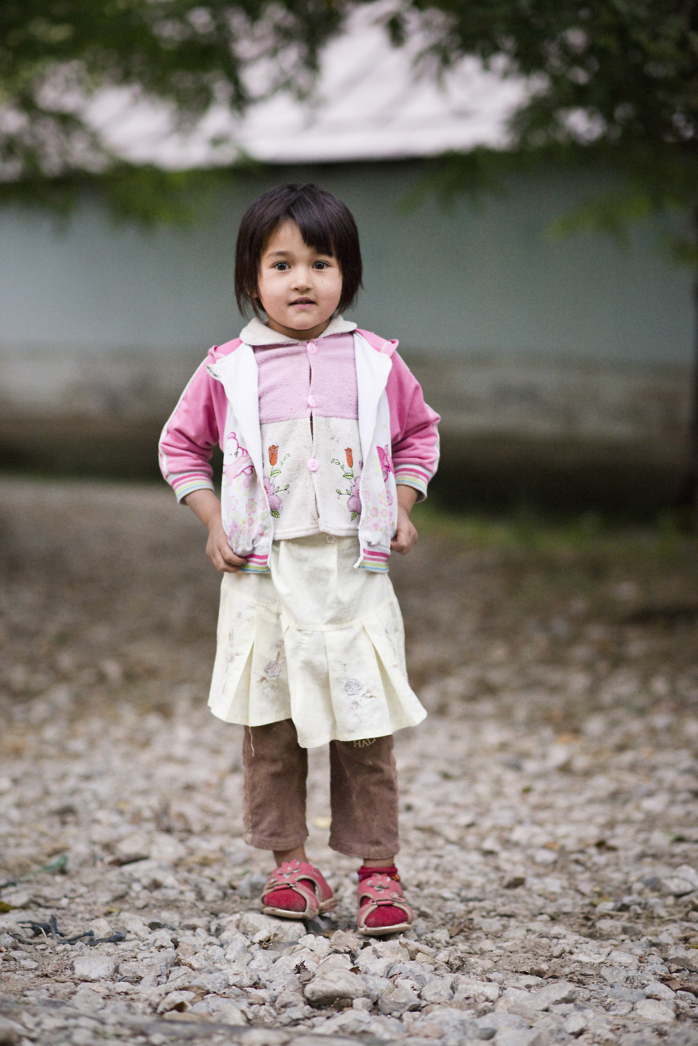 Mahaiba stands for a photo near her home in the mono-ethnic Uzbek town of Arslanbob in Southern Kyrgyzstan in Sept 2013.