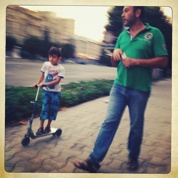 A father and son make their way down Rudakli, one of the main streets in Dushanbe. The city hosted high level meetings on water cooperation these past days and as a result most roads were closed to cars. (at Dushanbe, Tajikistan)