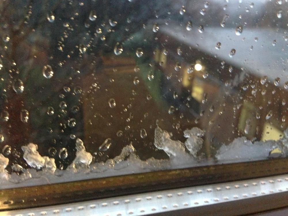 icy rain balanced on the windowsill