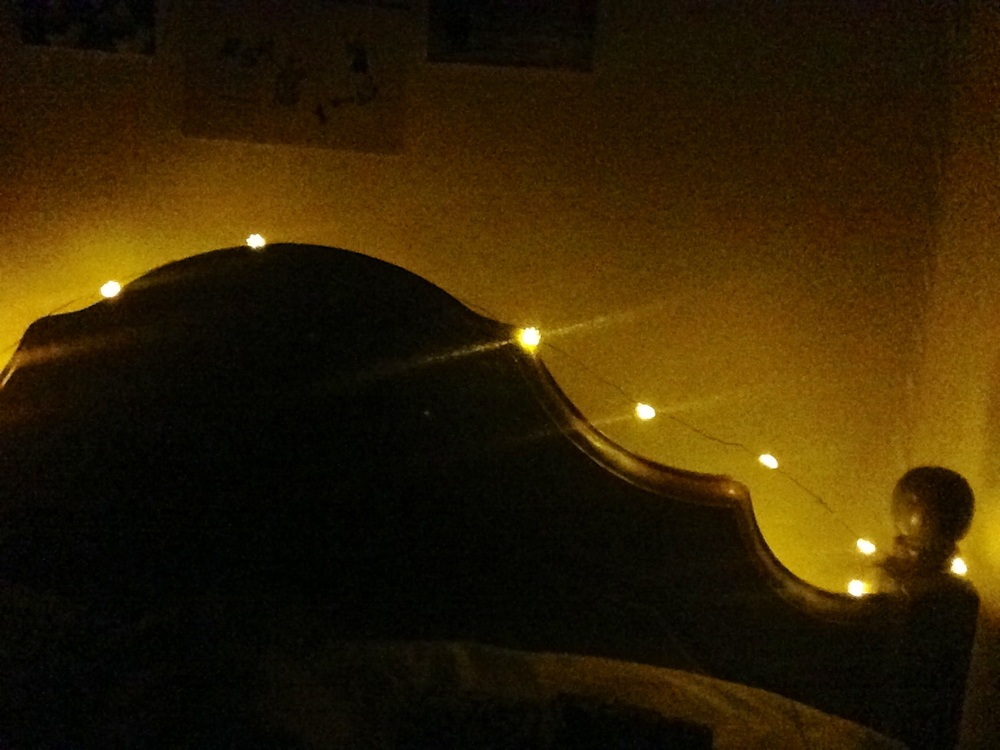 My cozy bed, lit with little golden suns, is very welcoming after a cold day spent outside