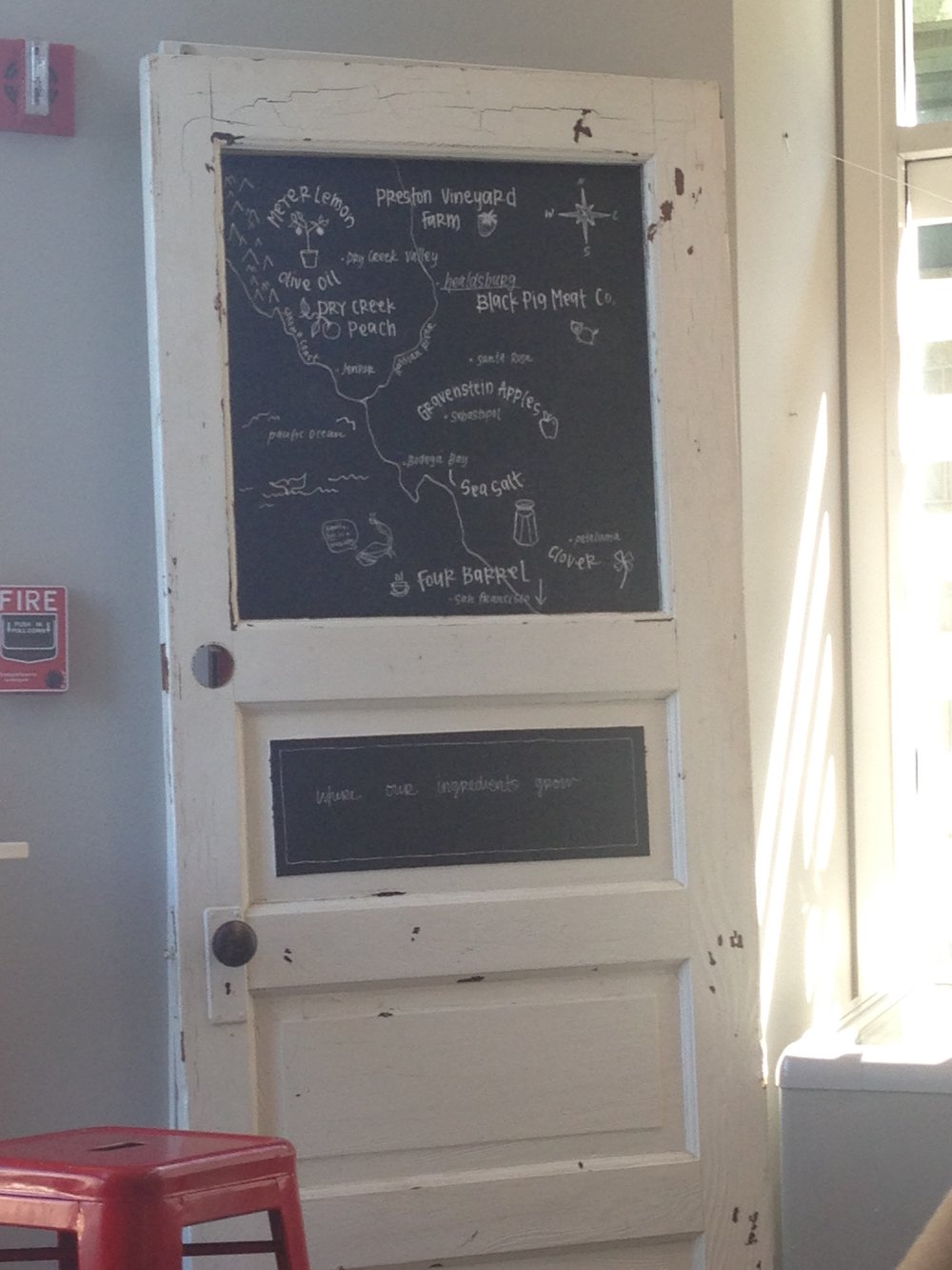 The cupcake place had written on this door all the areas their ingredients came from. Very cool and very local!