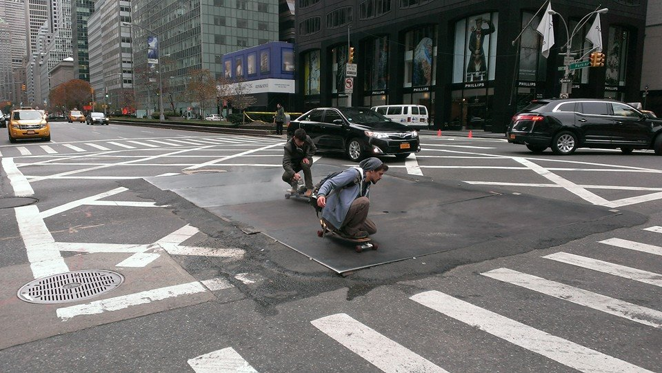Charles braving NYC streets to take a long-board shot