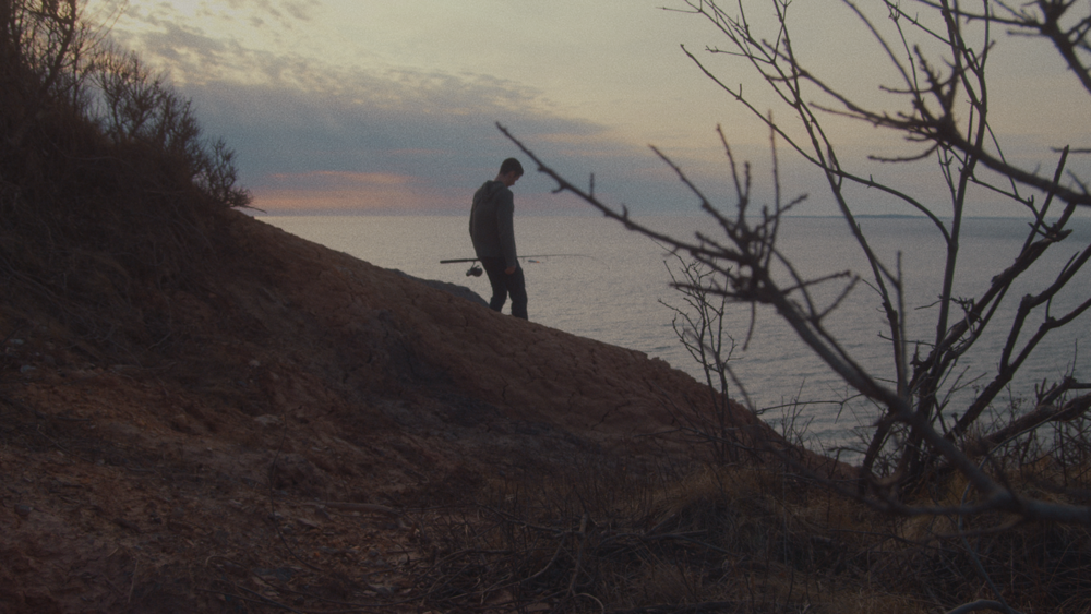 David makes his way down to the ocean's edge