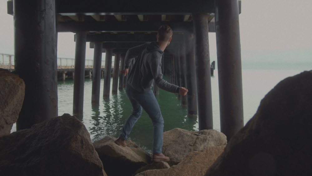Kyle tries to skip stones with variable success