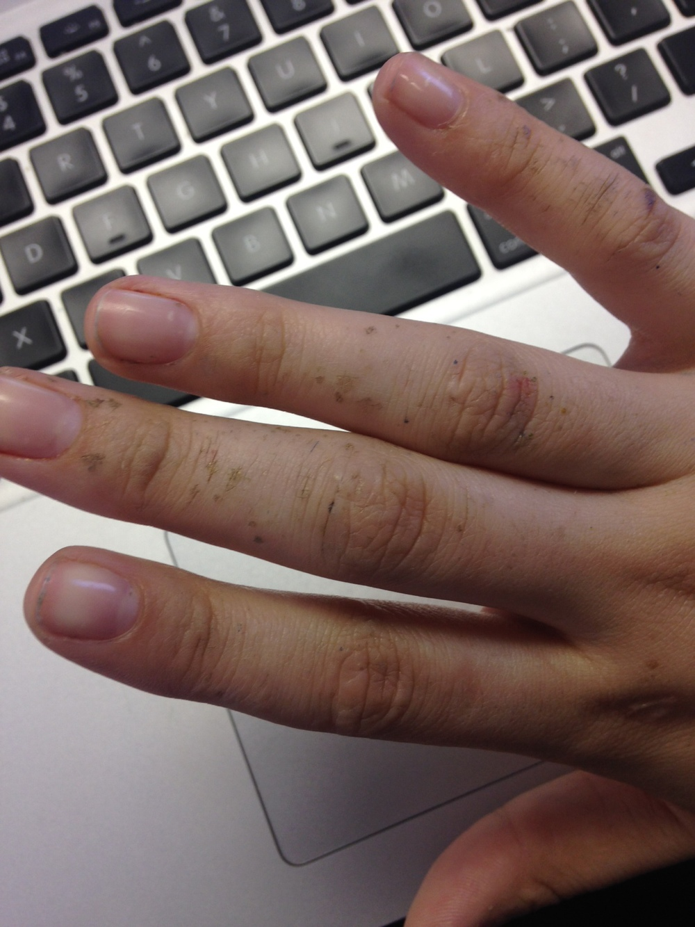 While I adore nail polish, I just can't seem to wear it. I work with a lot of white negative space, and having little red streaks from my nails touching the surface of my paper is endlessly infuriating.