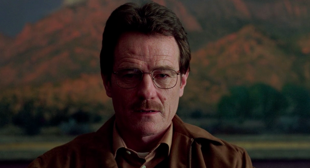 Notice that Walt's background is completely dominated by a landscape painting, a domesticated form of wildness, which rather than feeling expansive like the real desert outside, creates an unsettling claustrophobia.