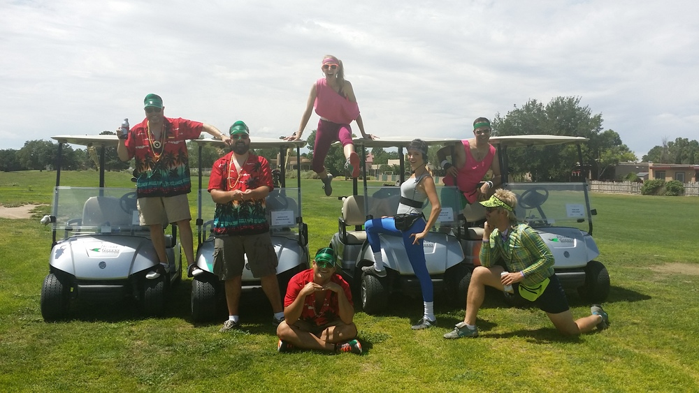 "Team ""Swingers"" and Team ""Putts of Steel"" take a break from golf.  Putts of Steel took home the trophy for best costume."
