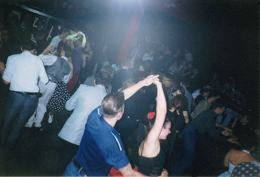Young couples dancing at a party