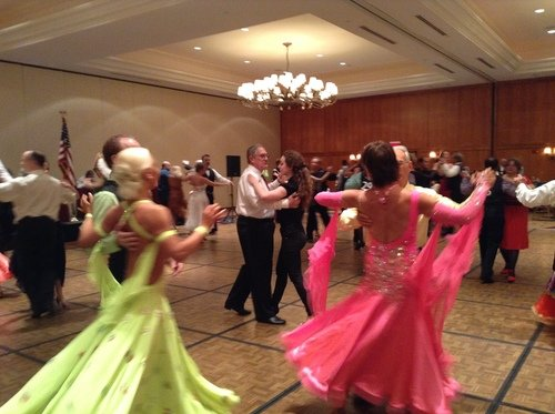 Couples dancing at ballroom dance competition