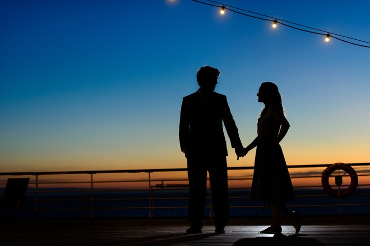 Couple Prepares for a Dance at Twilight on the Sea