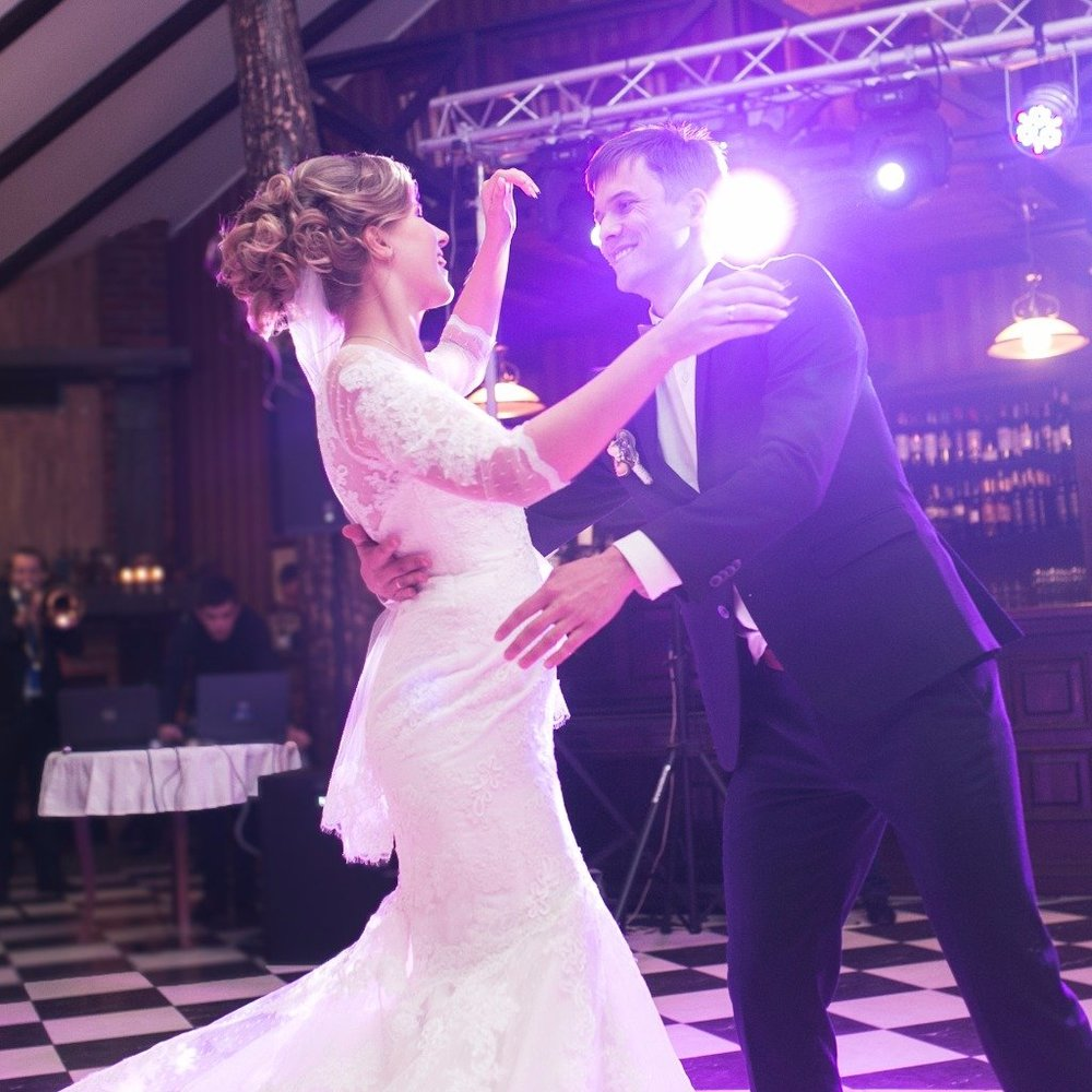 Choreographed Wedding Dance. Groom spinning his new bride during a choreographed dance learned with wedding dance lessons