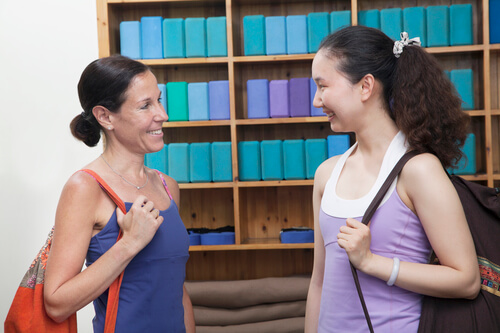 Two ladies making friends before taking dance lessons at a dance studio