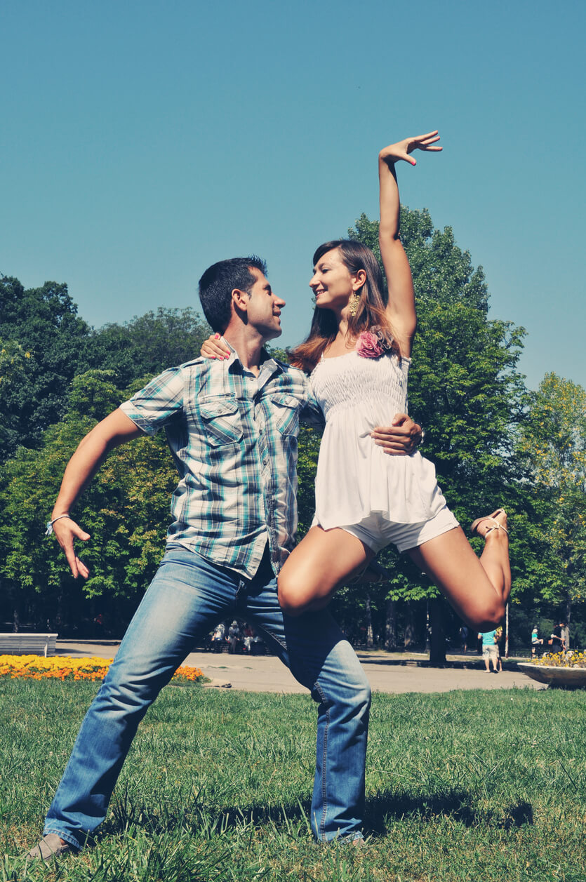 Healthy Lifestyle.Healthy and happy couple dancing outside.