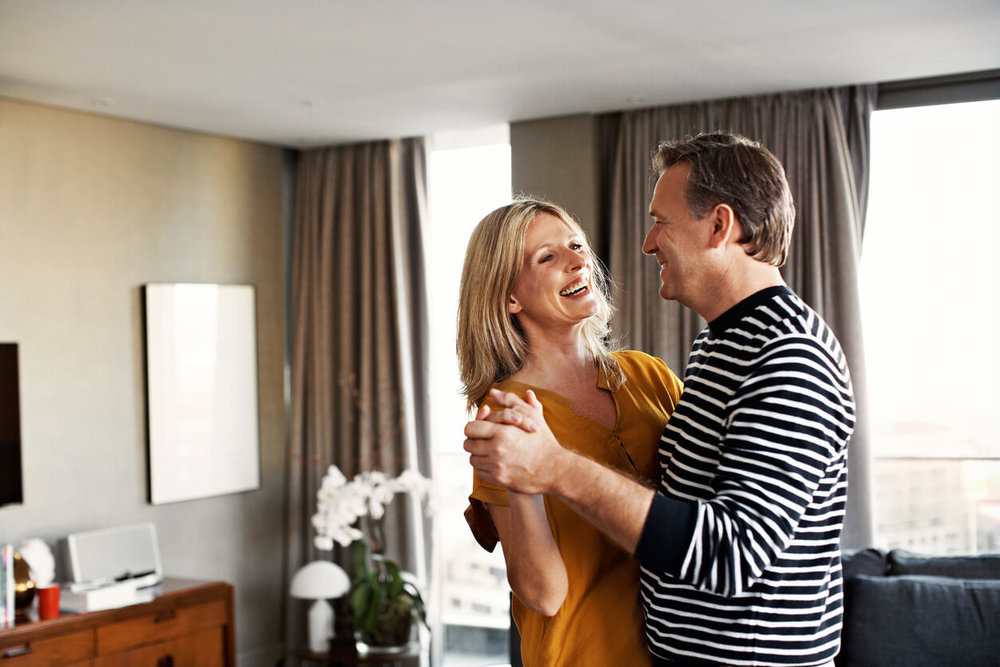 Dance is the universal language.Ballroom dance classes paying off at home - Couple dancing in living room