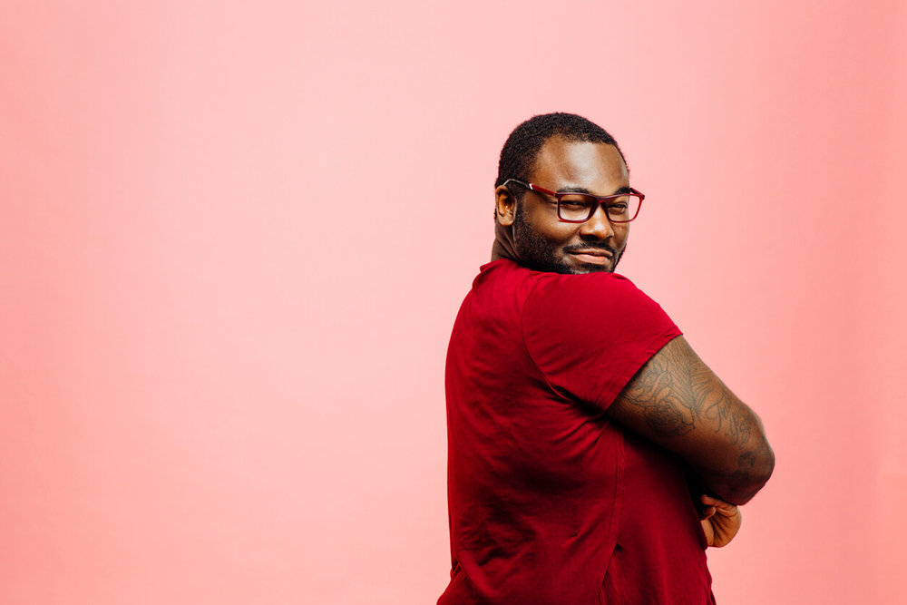 Confidence. Portrait of a confident plus size man in red shirt and glasses looking back at camera - ballroom dance classes concept