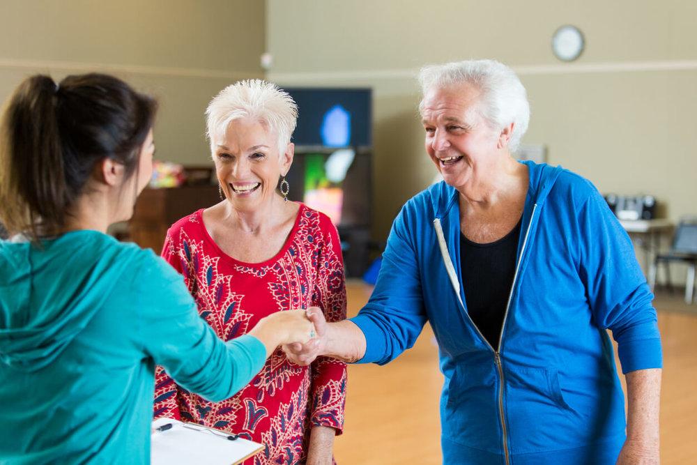 Ballroom Dance Class - Senior couple shake hands with an instructor at their first ballroom dance class