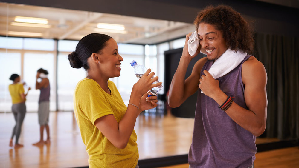 Dance class. Striking up a conversation and laughing after a ballroom dance class for fitness