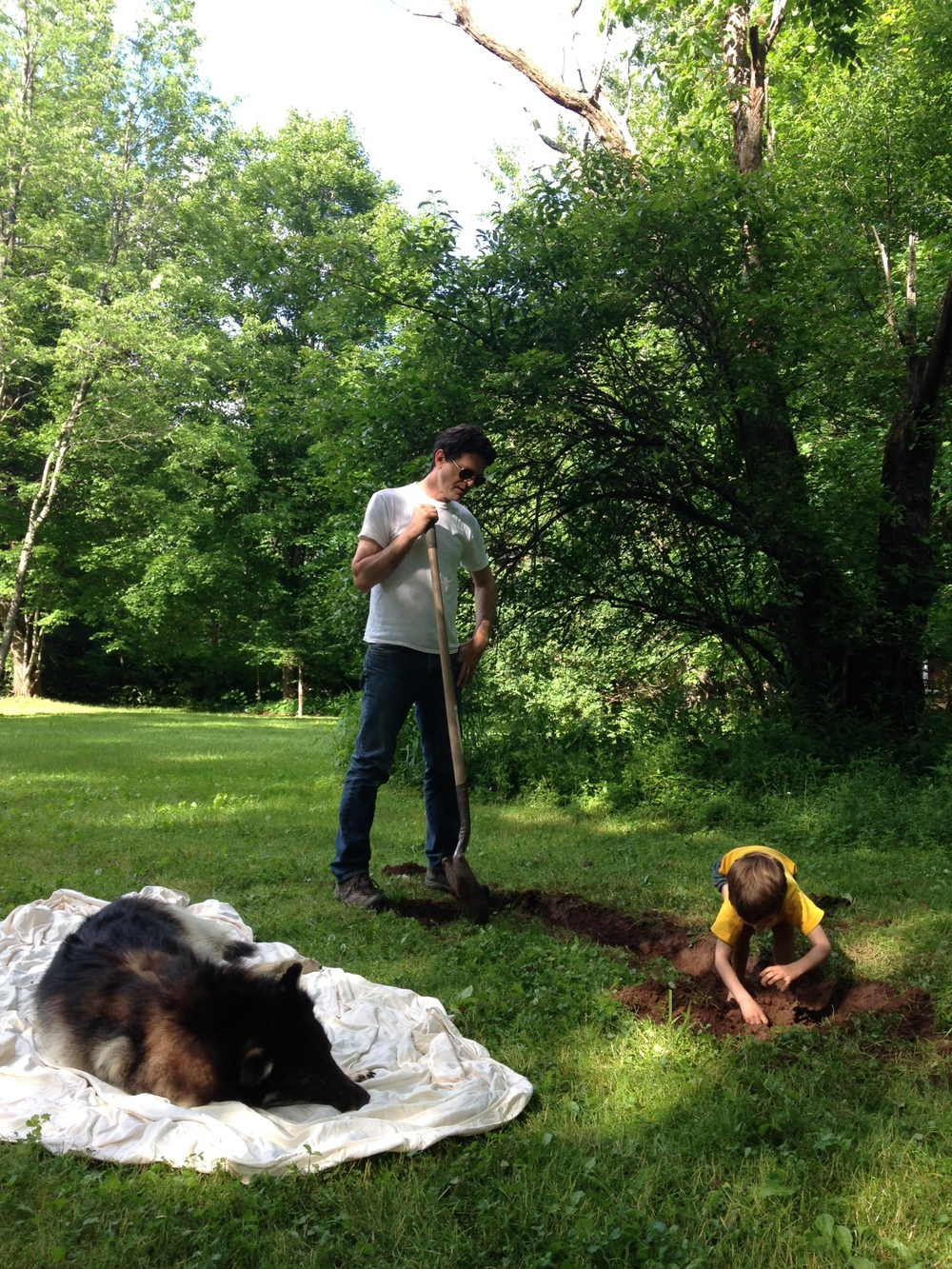 Here is a quick iphone shot I took of my husband, playing my dad,  who dug the grave for our dog in our backyard.
