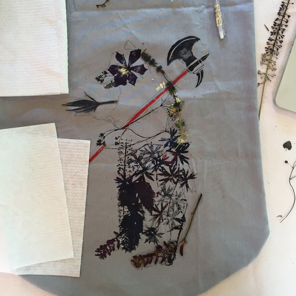 After choosing which pressed plants I want to use to compose the bear, I start to paint each specimen with fabric paint and the press it onto the fabric with a paper towel on the back to absorb any excess ink.