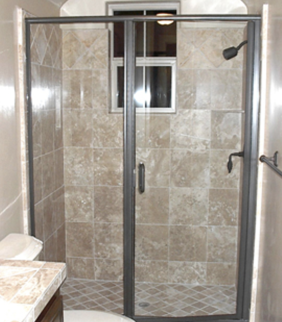 Semi-Frameless Hinged Shower Door (Photo courtesy of americanshowerandtubdoor.com) The least expensive option for a hinged shower, semi-frameless shower doors have a frame at the sides, bottom and top of the enclosure to stabilize the glass. The glass door itself has a full length integrated metal hinge on the hinge side but no metal border otherwise. This door has clear glass with brushed nickel finish.