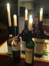 Arrange a wine bottle vignette, adding green and white candles!