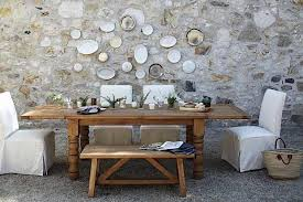 Inspiration dining furniture, use organic woods, layer textiles and chair style. Another feature would be to install a wood stove or cobblestone fireplace.