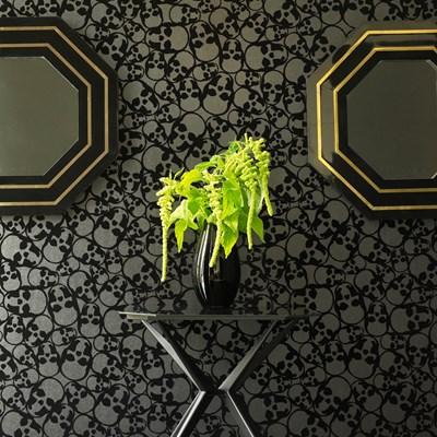 Sculls by Graham & Brown, Matte finish black paper with embossed velvet skull pattern.