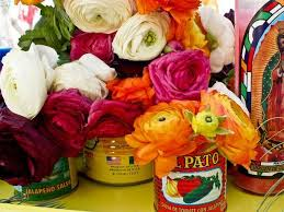 Create fresh posies in tomato cans, or mason jars!