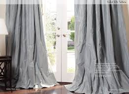 Dress the windows in your MOOR space with shantung or faux silk draperies.......reflecting  light in the room and drama!