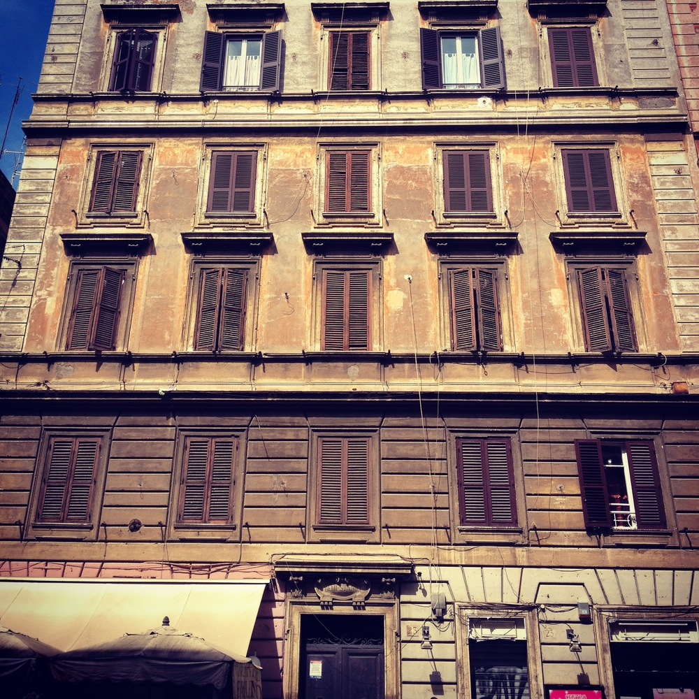 Old + colourful facades line the city streets