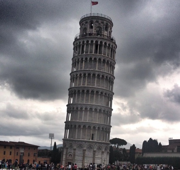 The famous leaning tower of Pisa amongst the ominous clouds.