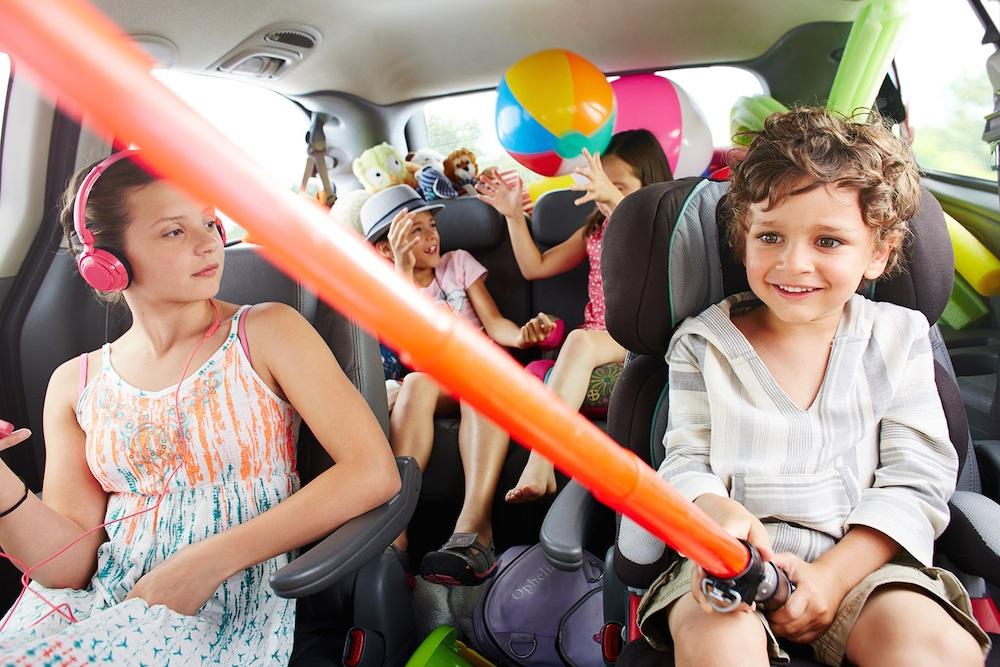 Road-trip-family-playing-toys-car.jpg