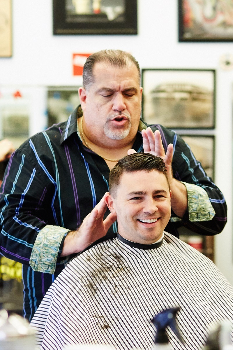 Barber-working-client-smiling.jpg